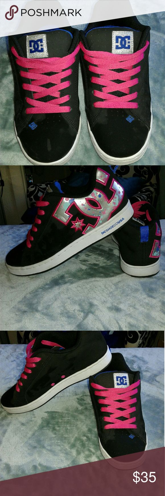 Women's DC Shoes black 7.5 Women's Pre owned,  GREAT condition!!! DC Shoes black with pink laces large pink/blue metallic DC logo on sides of shoes small DC logo on tongue US 7.5 Womens. Thanks for looking!!! DC Shoes Shoes Sneakers