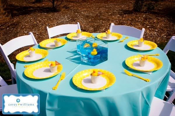 I like this setting but. I think I would do candy bowls rather than pools and the individual favors are a bit much for a kids party IMO.