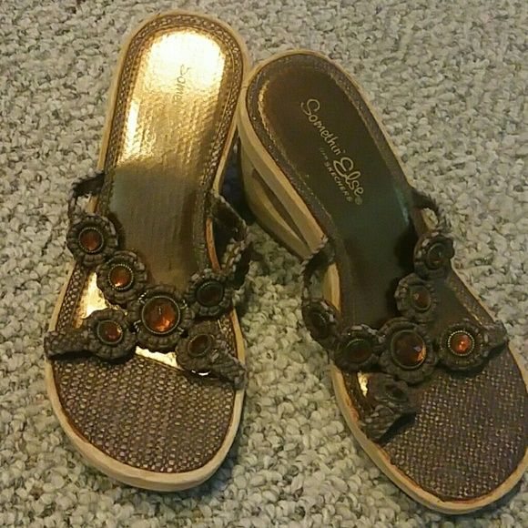 skechers  wedge sandals macrame  skechers sandals in brown and orange crystals in center slide on. beige sponge like platforms. wore a handful of times, size 6  great shape, no wear skechers Shoes Platforms