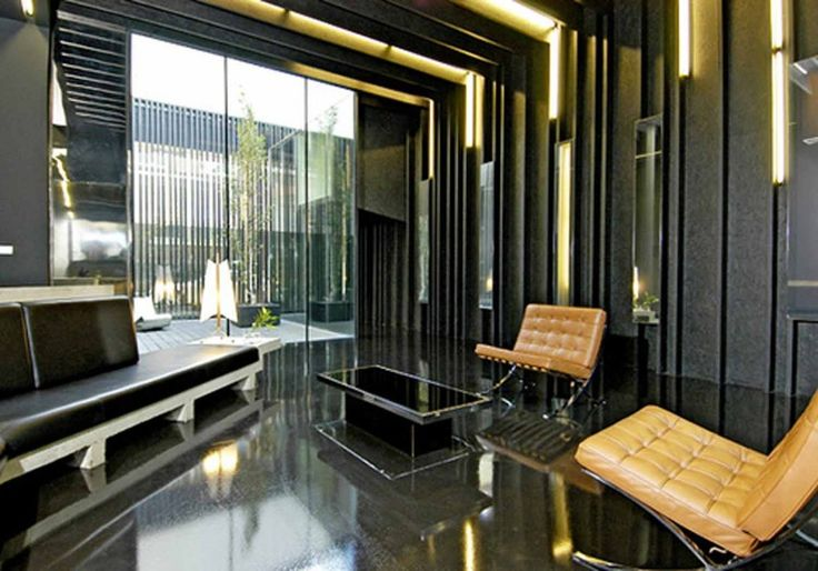 Interior Modern Apartment Design: Septum Of Light Modern Apartment Theme With Yellowish Accent Ceiling Lamp Also Black Grayish Ceramic Wall And Brownie Leather Settee On Matching Glossy Floor