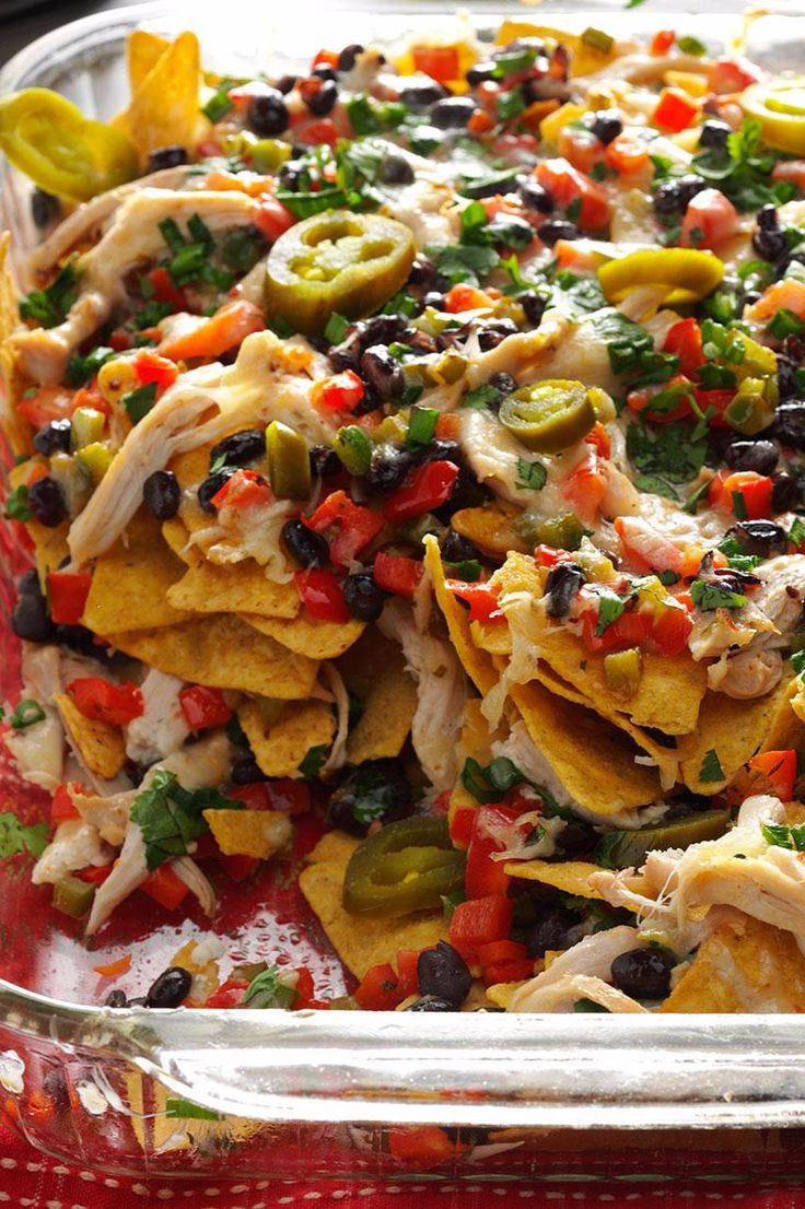 Here's a party appetizer that's delicious and so simple. Rotisserie (or leftover) chicken keeps it quick, and the seasonings and splash of lime juice lend fantastic flavor.  | Baked Chicken Nachos Recipe from Taste of Home