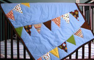Use your bunting to make add color to a boy or girl's baby blanket (or even one for every child if you have a lot of bunting!) - love this idea!
