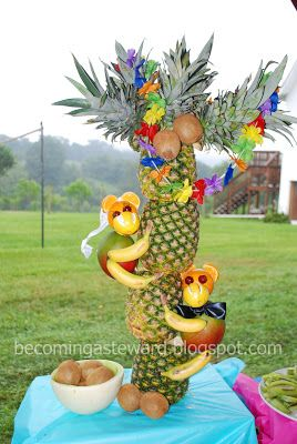 """Pineapple tree with kiwi """"coconuts"""" and bride and groom monkeys."""