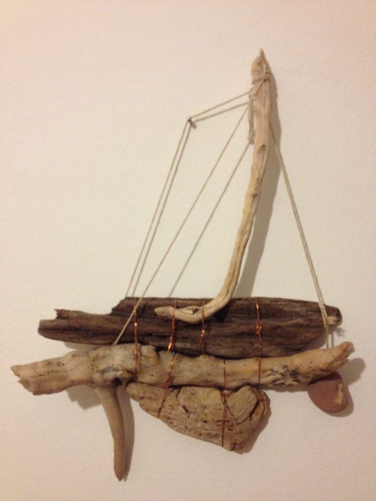 wood, cord, copper wire and a stone....