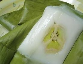 is a traditional steamed cake made from rice flour, coconut milk and sugar, filled with slices of banana
