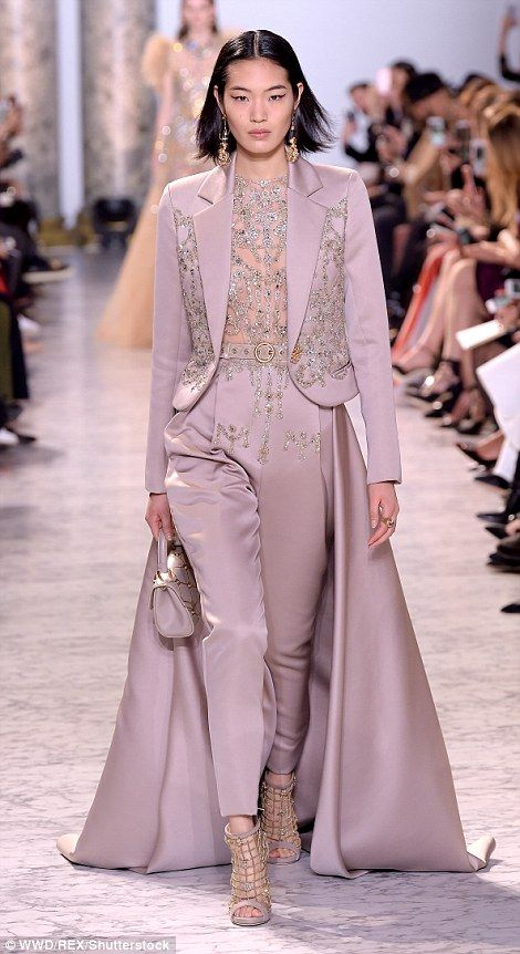 He also put a stunning new twist on the jumpsuit with this lilac one piece with a dramatic train and matching jacket