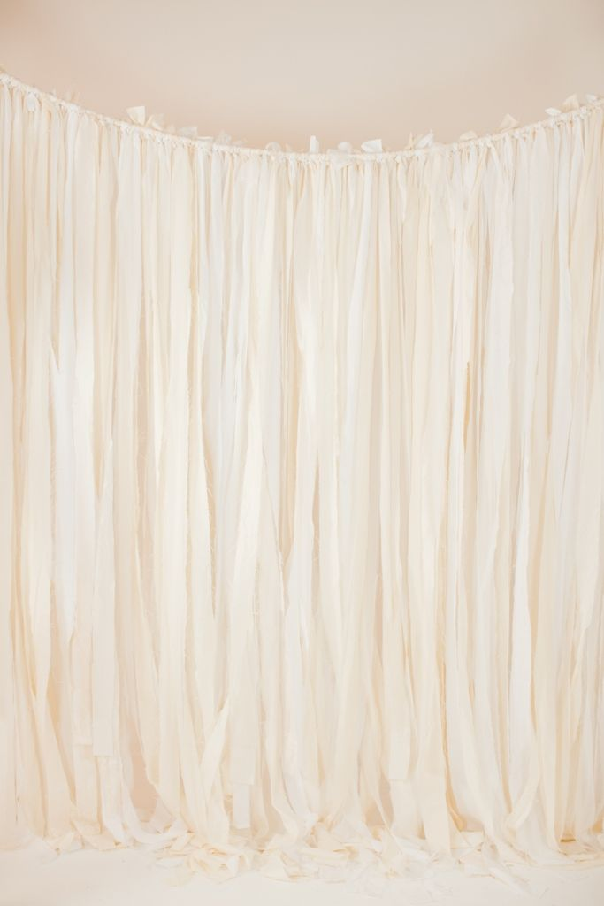 ivory ribbon backdrop: white and ivory ribbon backdrop. Maybe place lights in amongst the strands.