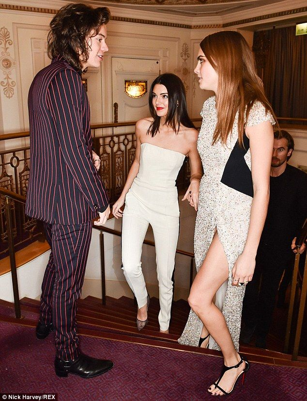 No awkwardness here: Harry Styles bumped into former flames Kendall Jenner (C) and Cara Delevingne at the British Fashion Awards at the London Coliseum on Monday night
