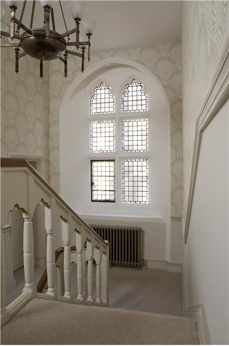 A hall in Lotus BP 2009 with walls in Wimborne White Estate Emulsion and woodwork in Slipper Satin Estate Eggshell.