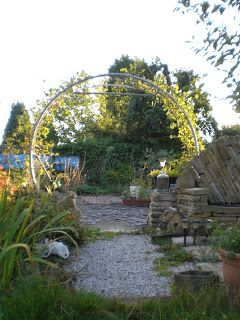 Recycled  trampoline arch/arbor/trellis-the upcycled answer to making a garden moondoor