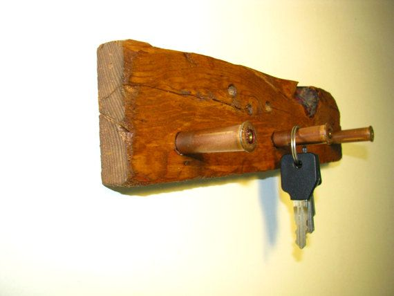 Hello and thanks for stopping by DebbenFarm. Here is a nice Rustic Key Holder using 3 Bullet Casings. It has an Old West feel plus it has several personally installed real bullet holes. We mounted it on an old piece of reclaimed wood found in the attic of an old barn in rural Missouri. The key holder shown in the picture has 3 empty bullet casing hooks to hang your keys. Maybe your favorite cowboy has trouble finding his keys. This is a great solution, plus anyone will think twice about…