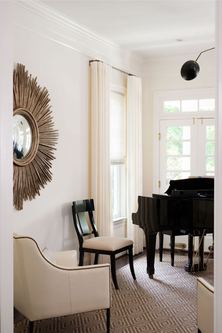 Classic black and white sitting room by Ella Scott Design. Come see the dramatic Before & After: Fussy Traditional to Urban Chic! #classicdecor #sittingroom #sunburst #blackandwhite