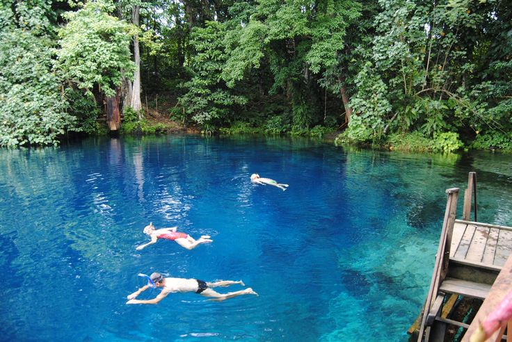 14 natural swimming pools Nanda Blue Hole. How beautiful. I wish I was that person floating on my back over there!