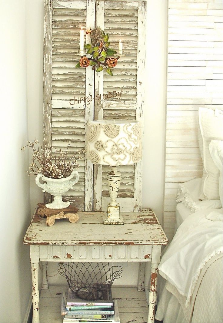 Salvaged Shutters - chippy shutters repurposed and used in home decor.  This is a great way to add a wall sconce, because the wires are hidden by the shutters and there are no holes put in the wall - Belle Escape