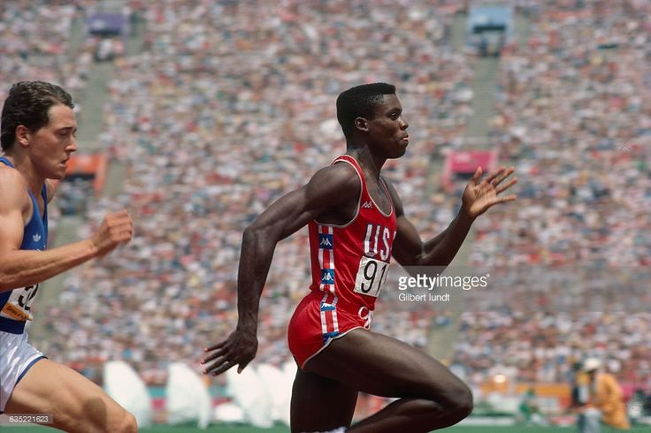 American sprinter Carl Lewis competes in a sprint competition at the 1984 Summer Olympics in Los Angeles. Lewis would go on to win four gold medals in track and field at the 1984 Olympics.