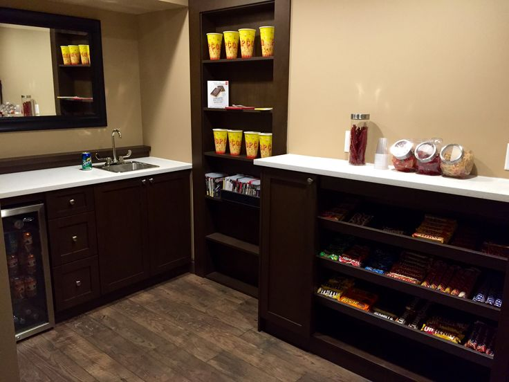 Concession Area with mini fridge and sink connected to movie theatre