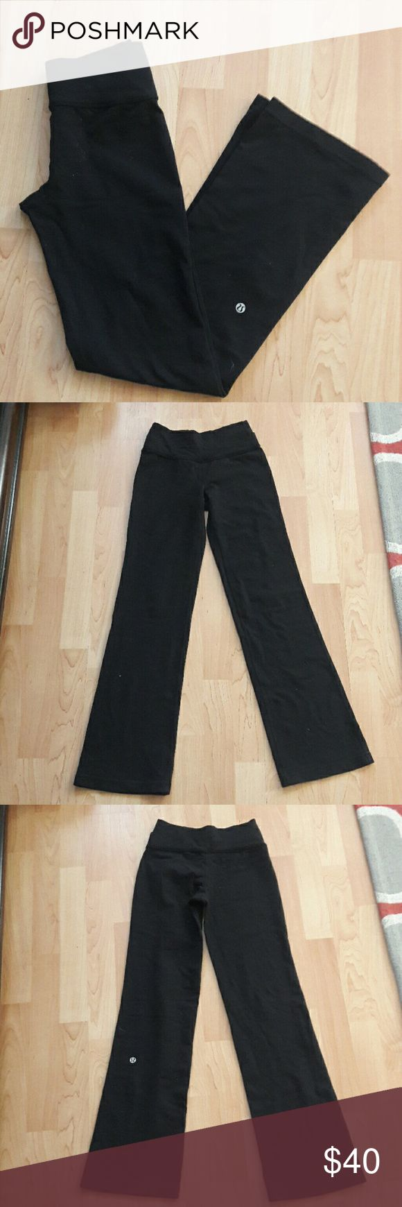 Lululemon yoga pants size 2 In good condition  Size is 2tall but I took these to be tailored at a Lululemon store so it is profesonally done !  As shown in photo. I'm 5'2 and these fit great! It is like a petite size 2! Very comfy! :-) Photos of models are not axrHal pant photos but look exactly the same when wearing :-)  Checkout My listings for more awesome stuff! lululemon athletica Pants Leggings