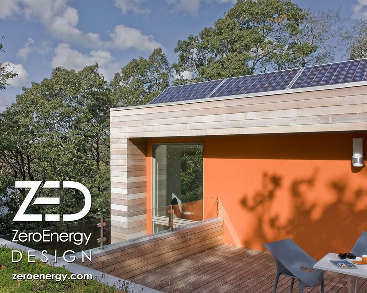 Roof deck for bird watching in modern home. Solar panels provide electricity, while a green roof completes the lush treetop view when seated. Cedar siding, FSC certified Ipe decking, and colorful fiber cement panels complete the material palette. Green home by modern architect ZeroEnergy Design. www.ZeroEnergy.com