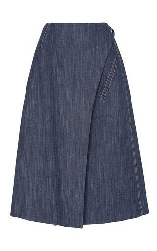 This Adam Lippes skirt features a wrap style with a knee length hem, юбка джинсовая, юбка из денима, синяя юбка, юбка с запАхом, юбка на запАх, юбка миди, Можно сшить индивидуально, по вашим меркам, в интернет-ателье Namaha3d. www.livemaster.ru/namaha WhatsApp +380983457224