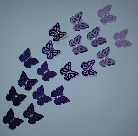 18 , 2 layered butterfly punches in 3 shades of purple. Each butterfly has 3 rhinestones in the center of the body for a little bling. These