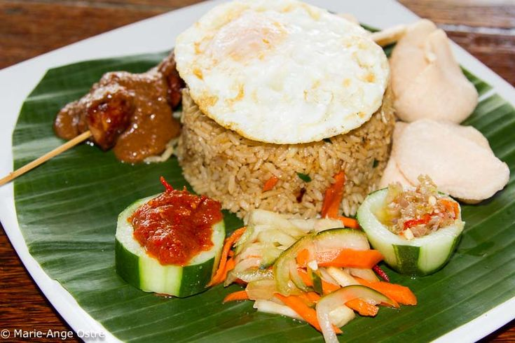 """Nasi goreng and mie goreng, Indonesian recipes"" In Indonesia, in all restaurants serving Indonesian food, you will find a classic dish: nasi goreng. The base is fried rice (nasi) sautéed with vegetables and some chicken or beef strips and will include, depending on the region, shrimps, a fried egg, and decorated with some fried dried onions. www.javasbeauty.com"