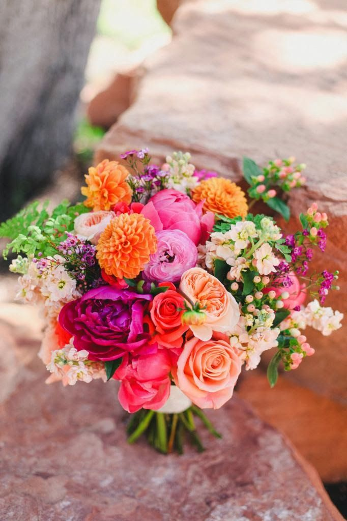 Bouquet by Blossom Sweet in shades of fuchsia, pink, and orange.