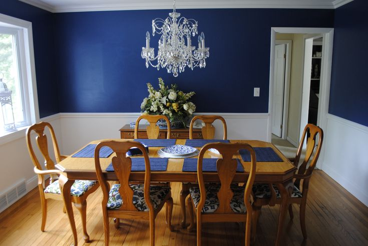 dining room navy blue walls with a chair rail and white bottom crystal schonbek chandelier. Black Bedroom Furniture Sets. Home Design Ideas