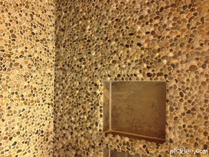 $53.00 in pebbles from Dollar store. Tile adhesive, grout and WA-LAH!!!!