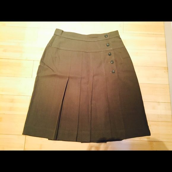 Escada military style skirt with pleats. Size 40. Escalating military style skirt. It has pleats and button closure. It's military green and has a great fit...looks great with even just a plain white t shirt. Wish it still fit me.  Escada Skirts Midi