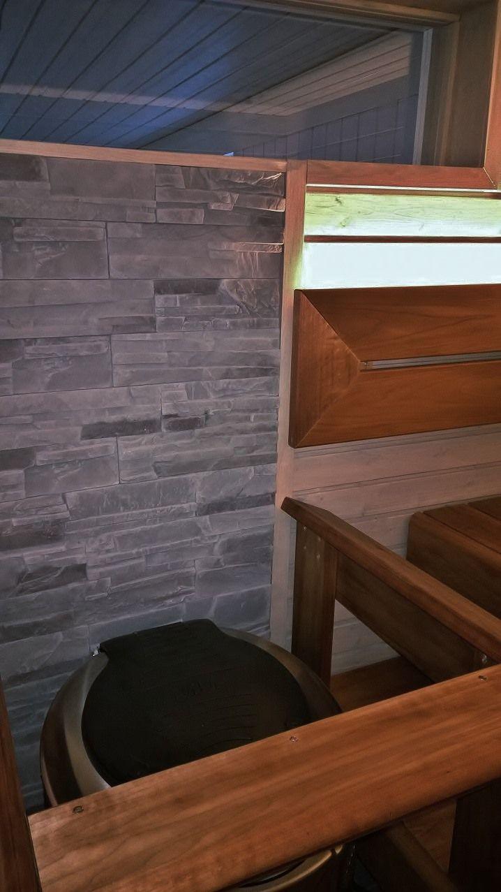 Sauna renovation. Swimming pool room behind the window.