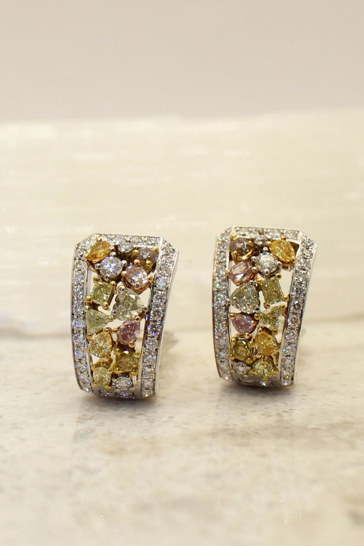 We can't think straight when these earrings come out of our vault! Part of a three piece collection, these are designed with 9 different natural coloured diamonds cut into 7 different shapes. 19k gold.  #coloredstones#diamonds #gemstone #exclusive#quality