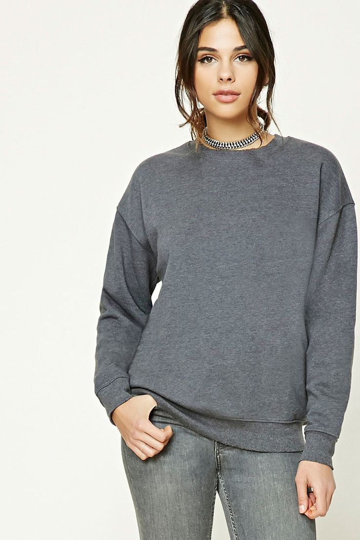 A heathered knit sweatshirt featuring a fleece lining, subtle raw-cut detail, long dropped sleeves, and ribbed trim.
