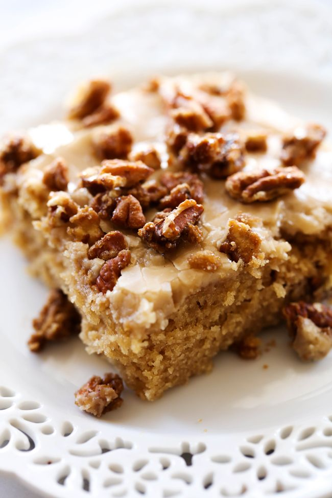 A moist and delicious brown sugar sheet cake with an amazing caramel frosting topped with sweet and crunchy pralines!!