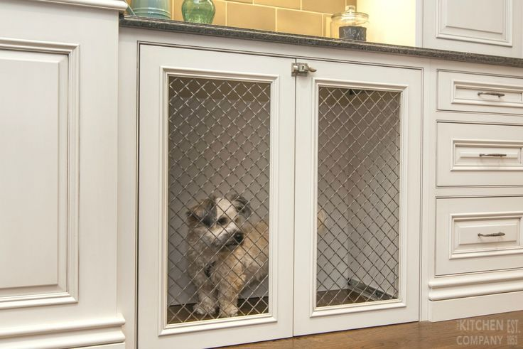 Custom Built-In Dog Crate Cabinetry: Crystal Cabinets with Custom Paint with pewter Glaze   Countertops: Granite and Wood   Traditional Backsplash   Pendant Lights   Designer: Ron Fisher   Location: Woodbridge, CT   The Kitchen Company   - Tap the pin for the most adorable pawtastic fur baby apparel! You'll love the dog clothes and cat clothes! <3