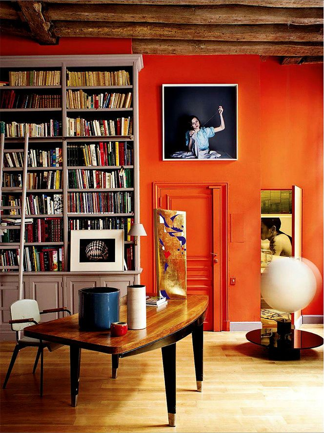 Home office with orange wall