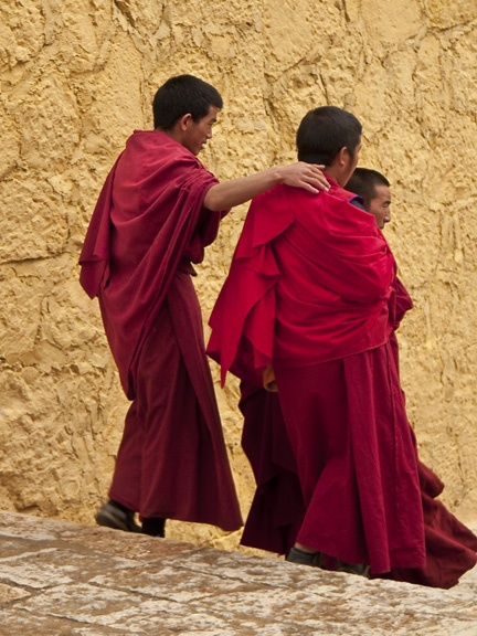 Young monks walk to the Zhongdian Monastery in Shangri-la, Yunnan, China.