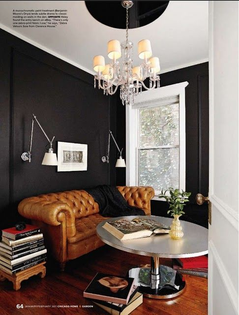 The black walls with white trim are a beautiful alternative to the traditional dark brown study. Love.