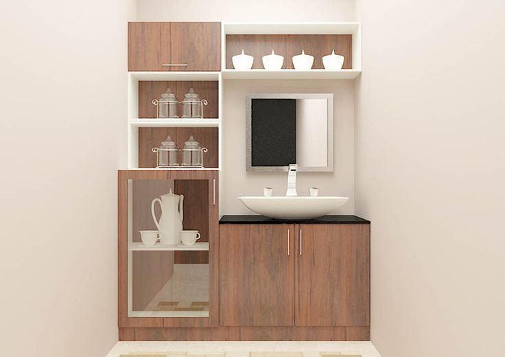 Crockery Unit made up of plywood with laminate finish.  Consisting glass/wooden door cabinets, racks, drawer to fit in essentials.  Dining room enhances it beauty by adding this beautiful crockery unit with great design.  This unit is attached with a wash basin unit and more used as multitasking unit.   The dual color combination makes this unit look adorning.
