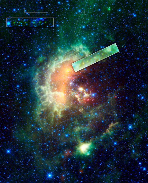 Asteroid Spotted Passing in Front of Stunning Space CloudCredit: NASA/JPL-Caltech/UCLAA new infrared image from NASA's Wide-field Infrared Survey Explorer (WISE) showcases the Tadpole nebula, a star-forming hub in the Auriga constellation about 12,000 light-years from Earth. The asteroid, 1719 Jens, left, tracks across the image, seen as a line of yellow-green dots in the boxes near center. A second asteroid was also observed cruising by, as highlighted in the boxes near the upper left.