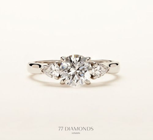 The central diamond of the Trilogy 'Barcelona' engagement ring is gracefully balanced by 2 matching pear cut diamonds.