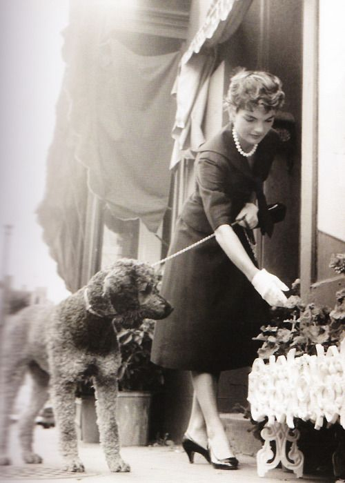 Jacqueline Bouvier Kennedy Onassis - with a poodle.  What a beautiful lady she was!
