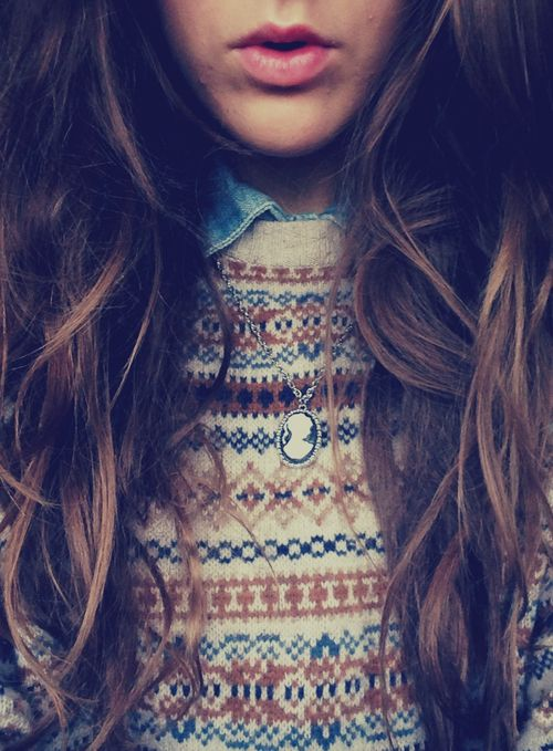 Knit patterned sweater, denim button up collared shirt and a Victorian cameo necklace