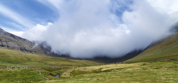 Enveloping Fog - The fog rolling down the valley of Gásadalur in the Faroe Islands.