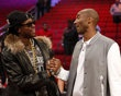 Recording artist 2 Chainz (left) greets Los Angeles Lakers player Kobe Bryant after the 2013 NBA all star slam dunk contest at the Toyota Center.