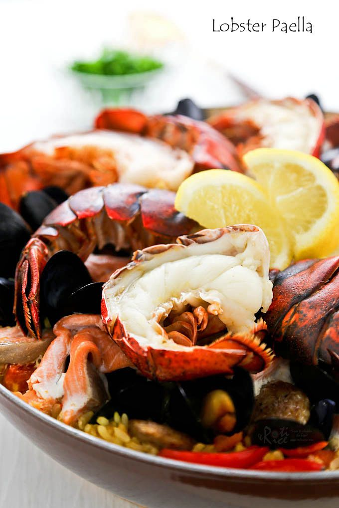 Wow family and friends with this delicious Lobster Paella studded with succulent lobster tails, mussels, salmon, and chorizo. They'll be back for seconds!   RotiNRice.com