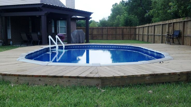 Countersunk above ground pool with deck... gives the feel of an inground pool for a fraction of the cost!  Love It!