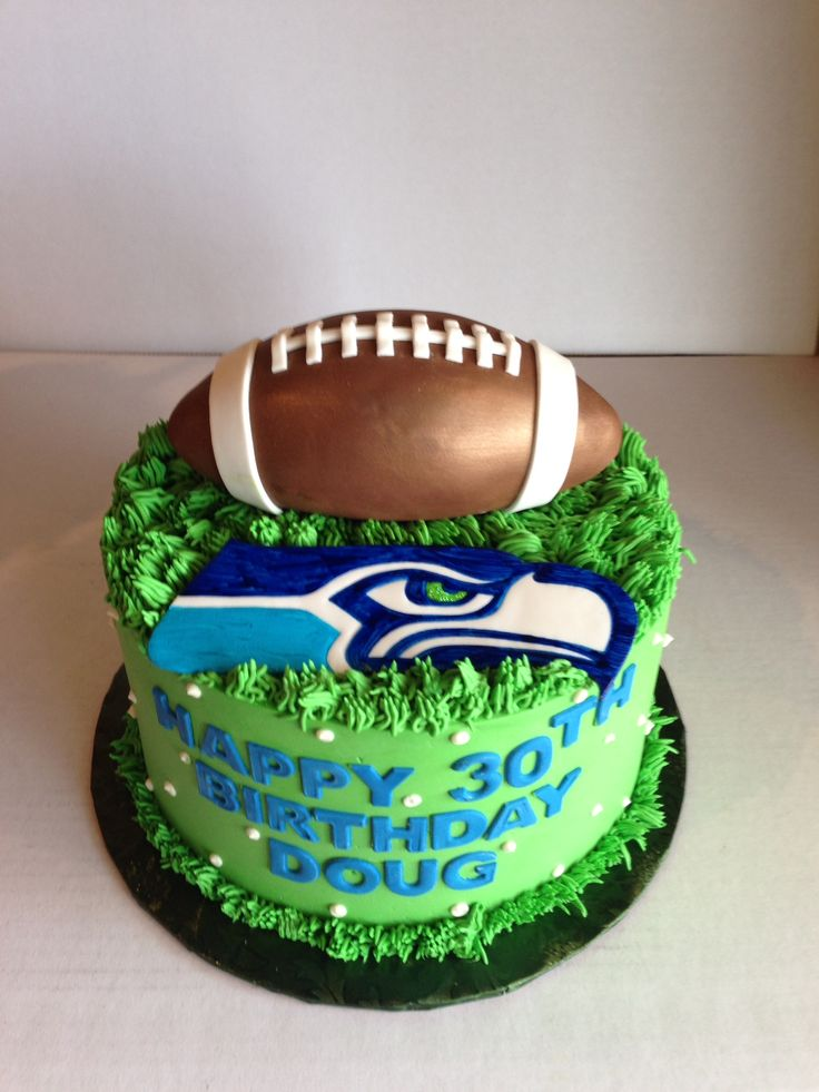 Seahawks birthday cake with fondant football.