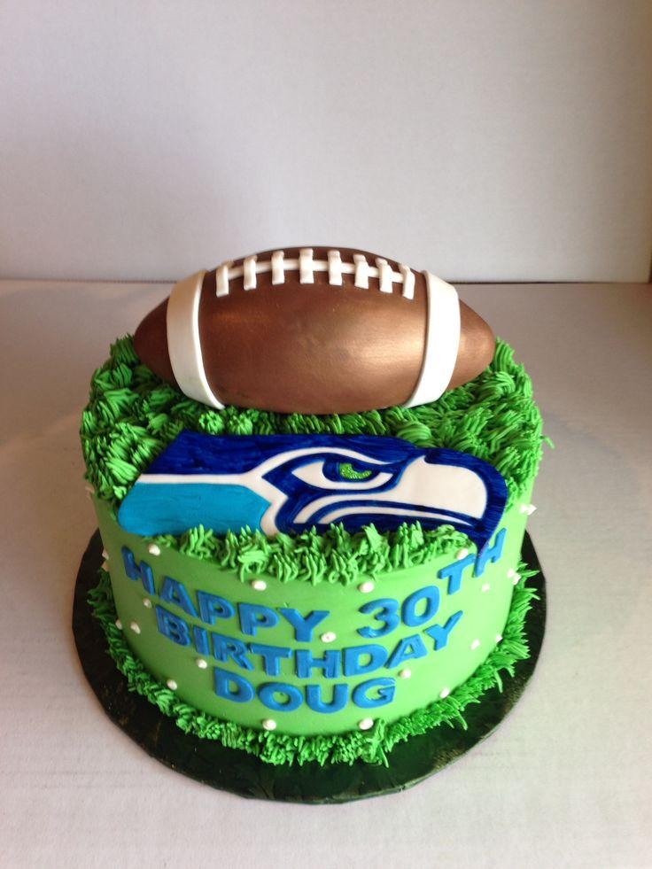 Seahawks birthday cake with fondant football.