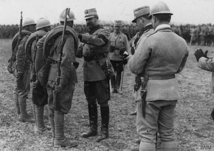 Soldiers being decorated by the King Ferdinand I of Romania in Racaciuni, 1917