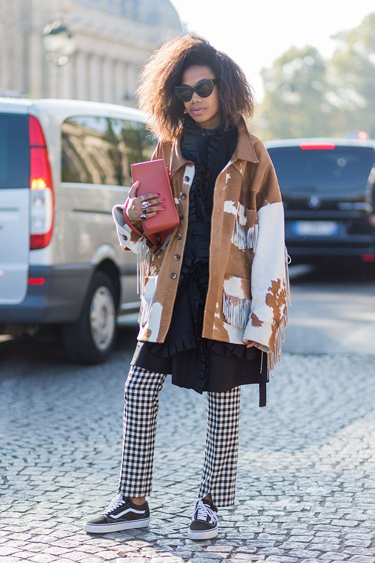 Mix up your prints: cow hide and gingham could sound like a cowgirl's nightmare, but by keeping the rest of the outfit chill (dark layers and Vans skate shoes), this is a winner